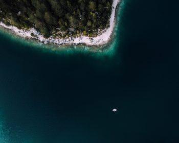 Aerial view of a cruise ship near an island