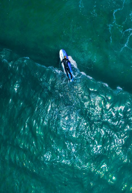 Aerial view of a person on a surfboard
