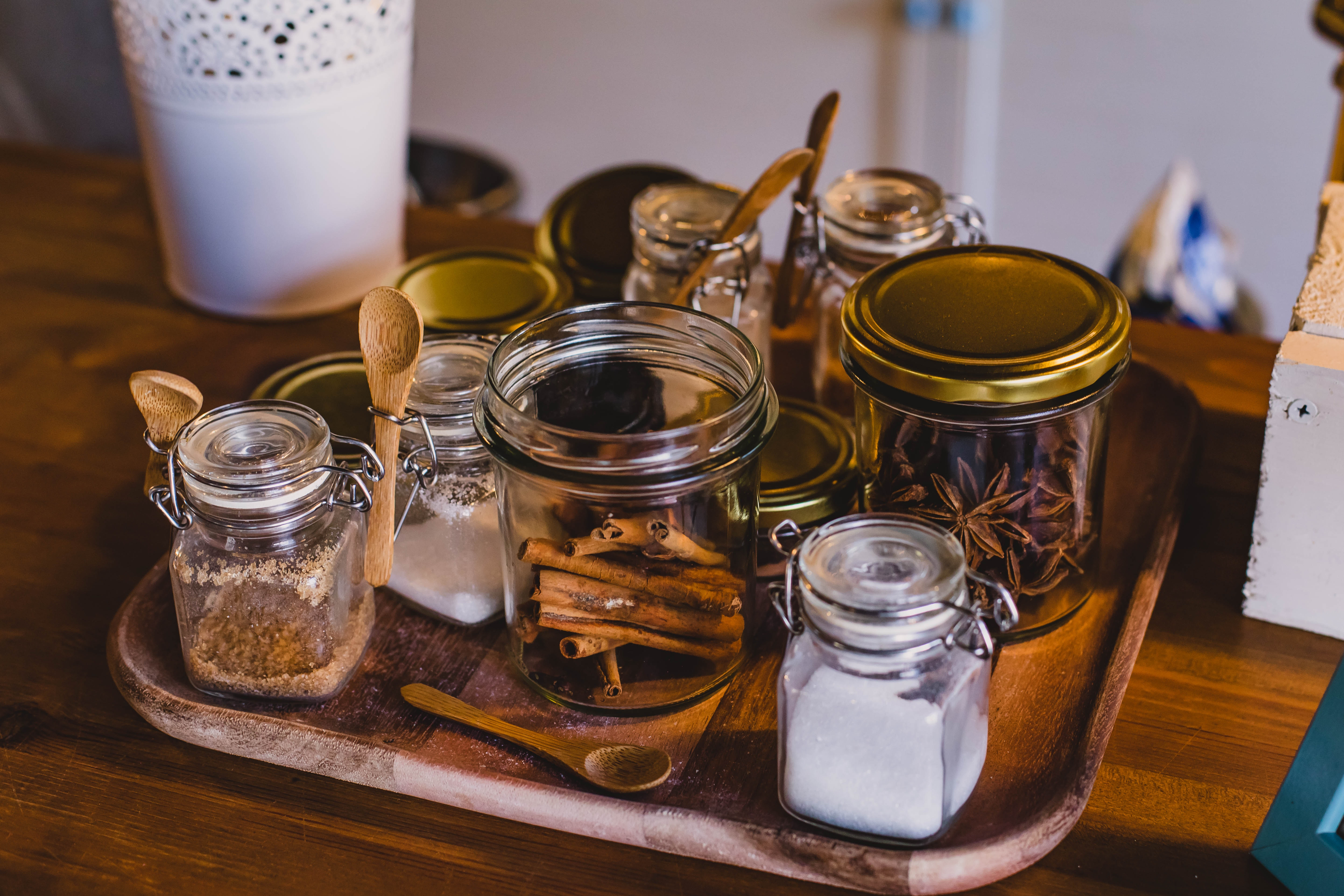 Clear glass jars on top of a tray