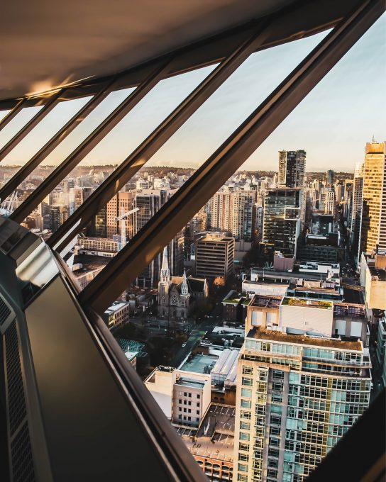 Clear glass windows overlooking a city