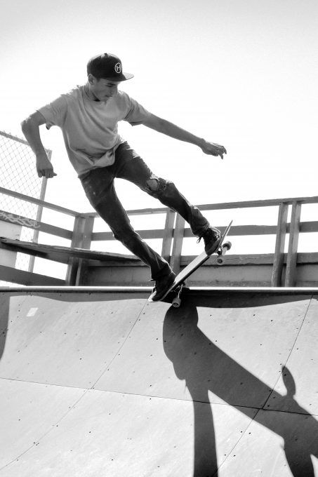 Grayscale photography of a man skateboarding on a ramp