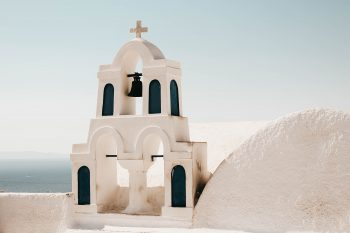 Photo of a church with a bell tower in Santorini