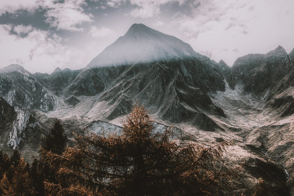Snow-covered mountain under a cloudy sky