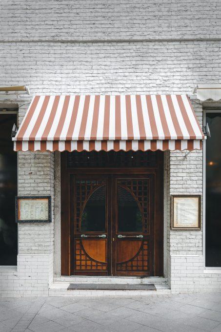 A closed brown wooden door