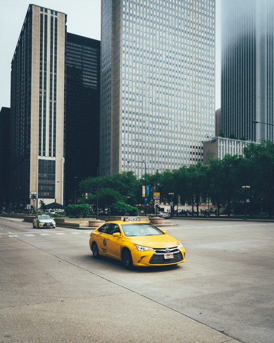 A yellow cab on the road
