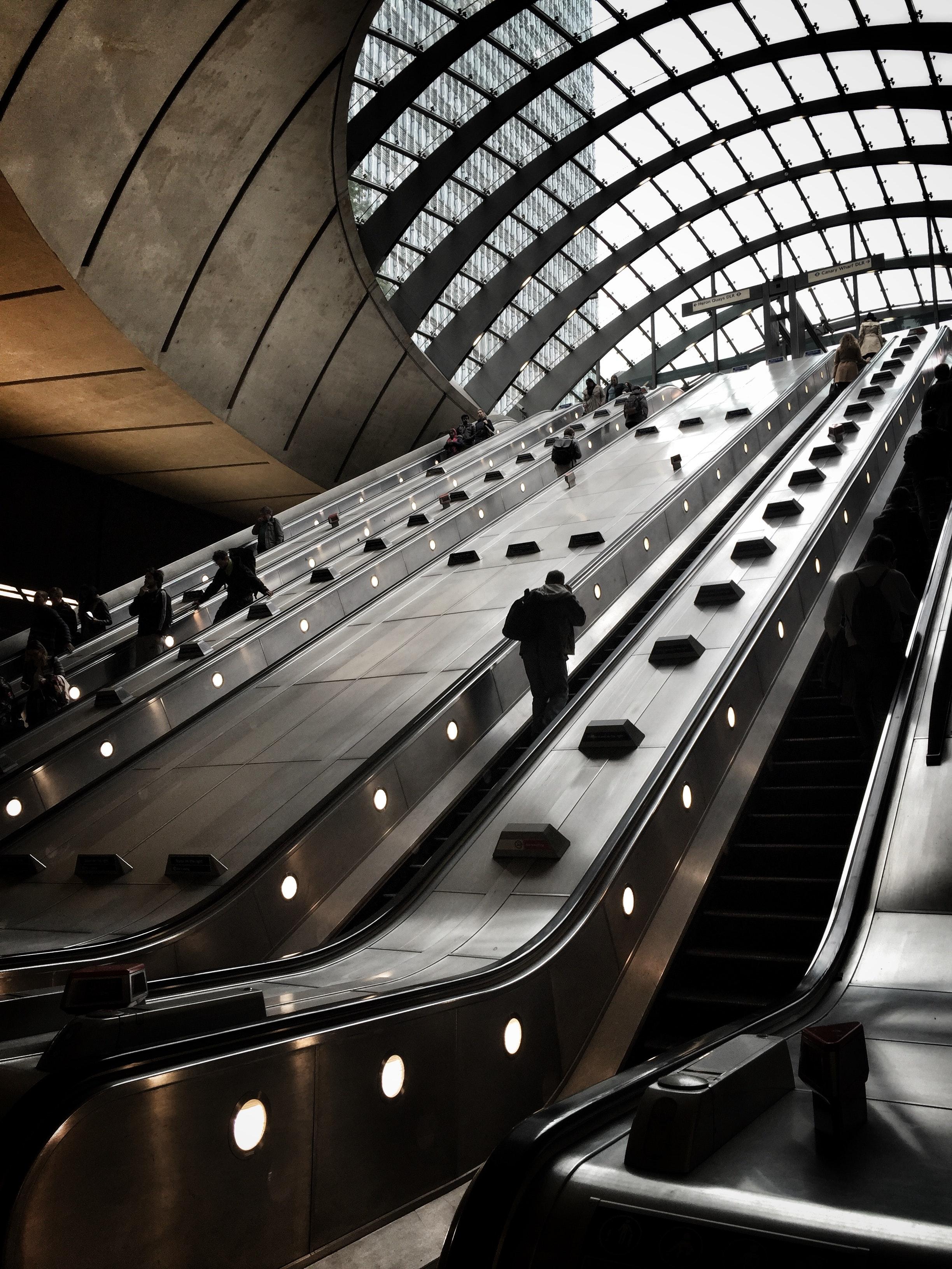 People on an escalator inside a building