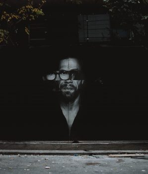 Photo of a man on a street wall