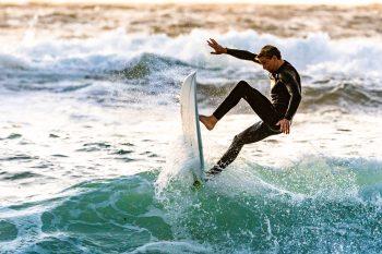 A surfer performing tricks
