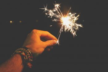 Photo of a person holding sparkler
