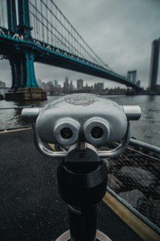 Tower viewer near a bridge during a cloudy day
