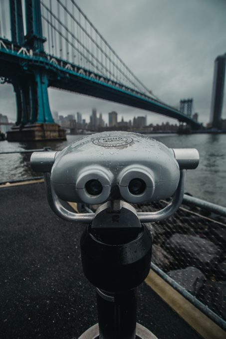 Tower viewer near a bridge during a cloudy day