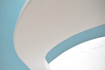 A curved white concrete panel