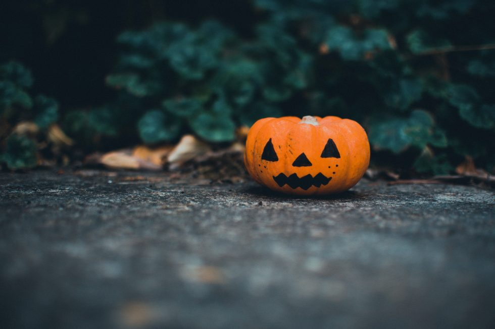 A Jack-o-lantern on the ground