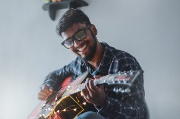 A man playing guitar