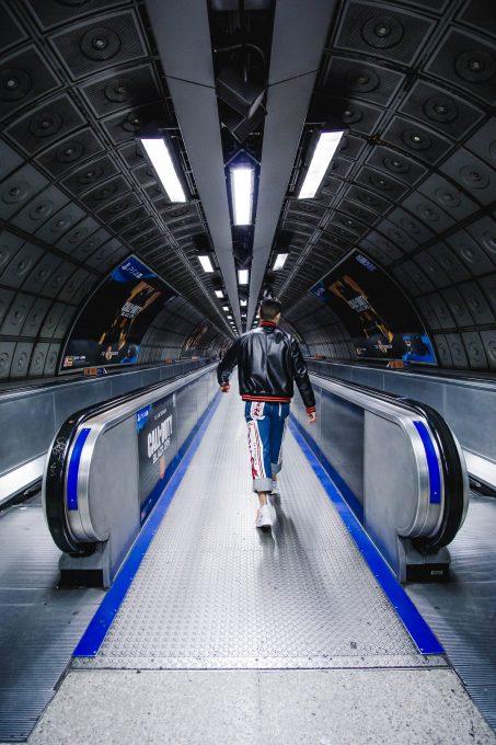 A man walking on an escalator