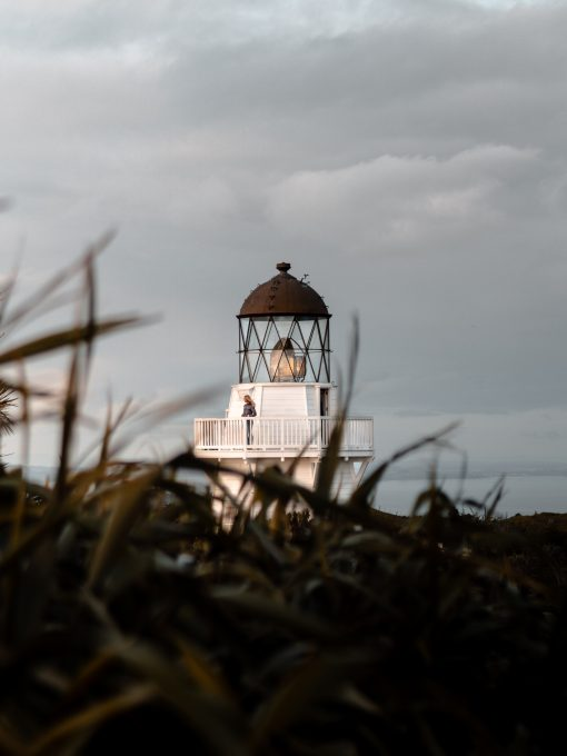 A person standing on a lighthouse