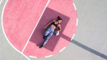 A woman lying on a basketball court