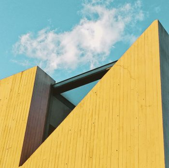 A yellow building on a background of blue sky