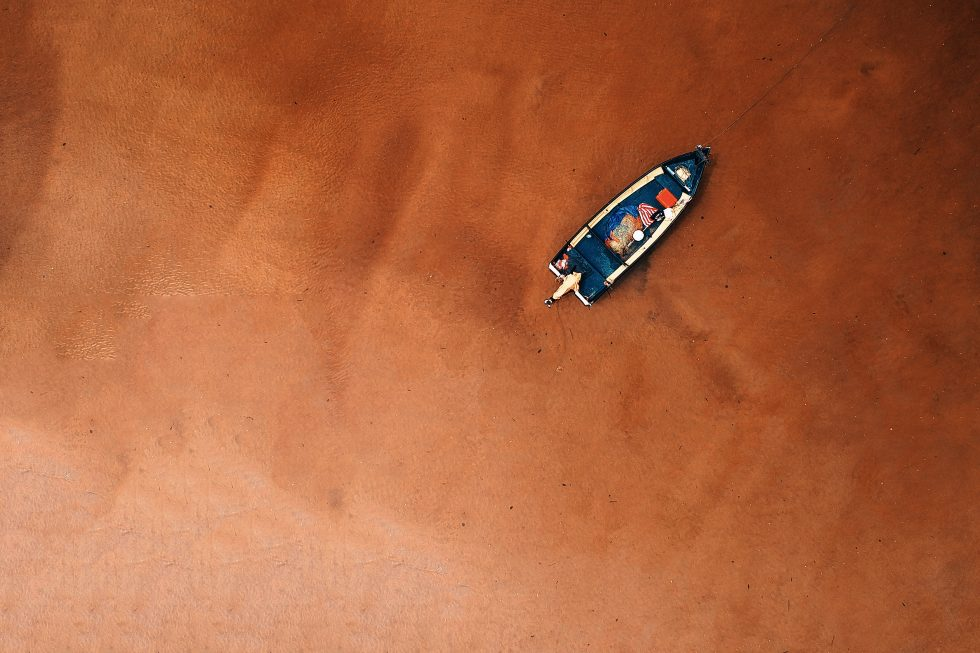 Bird's eye view of a boat on the seashore