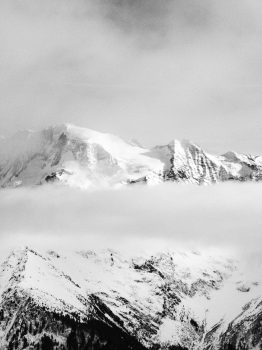 Black and white photo of a snow-covered rocky mountain