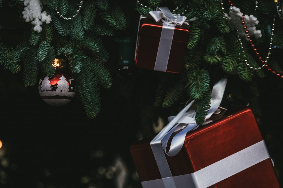 Gift boxes hanging on a Christmas tree