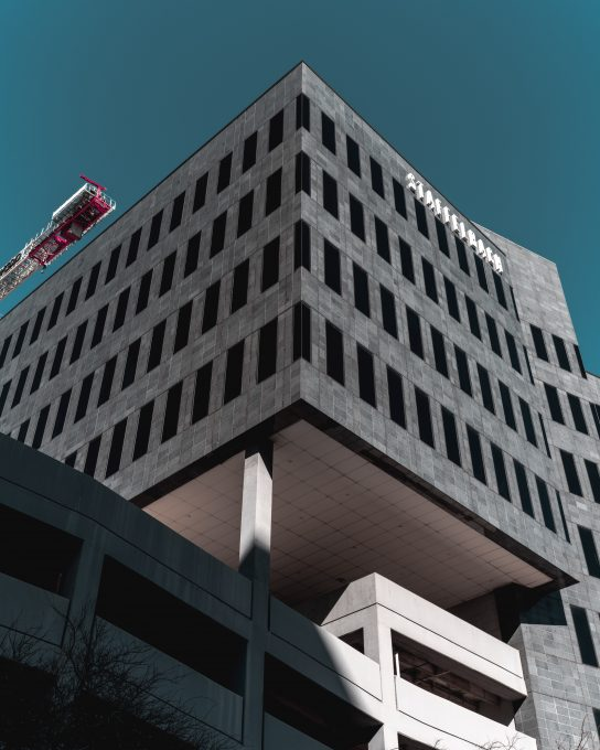 Low-angle photo of a black concrete building