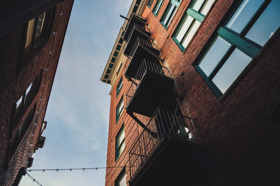 Low angle photography of red brick buildings