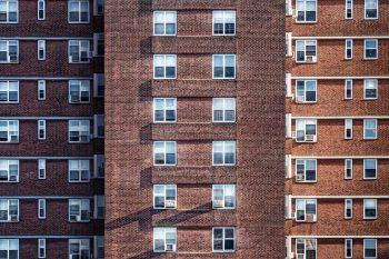 Multi-story brown brick houses