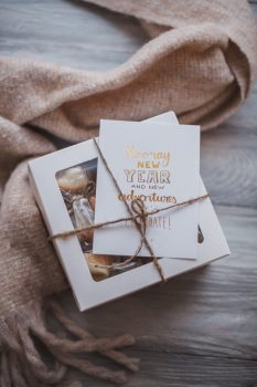 Photo of a gift with a white greeting card