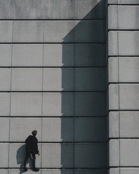 Photo of a man standing on a concrete building