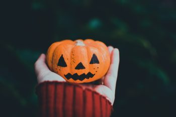 Photo of a person holding a Halloween pumpkin