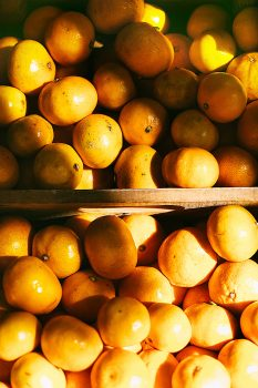 Photo of a pile of orange fruits