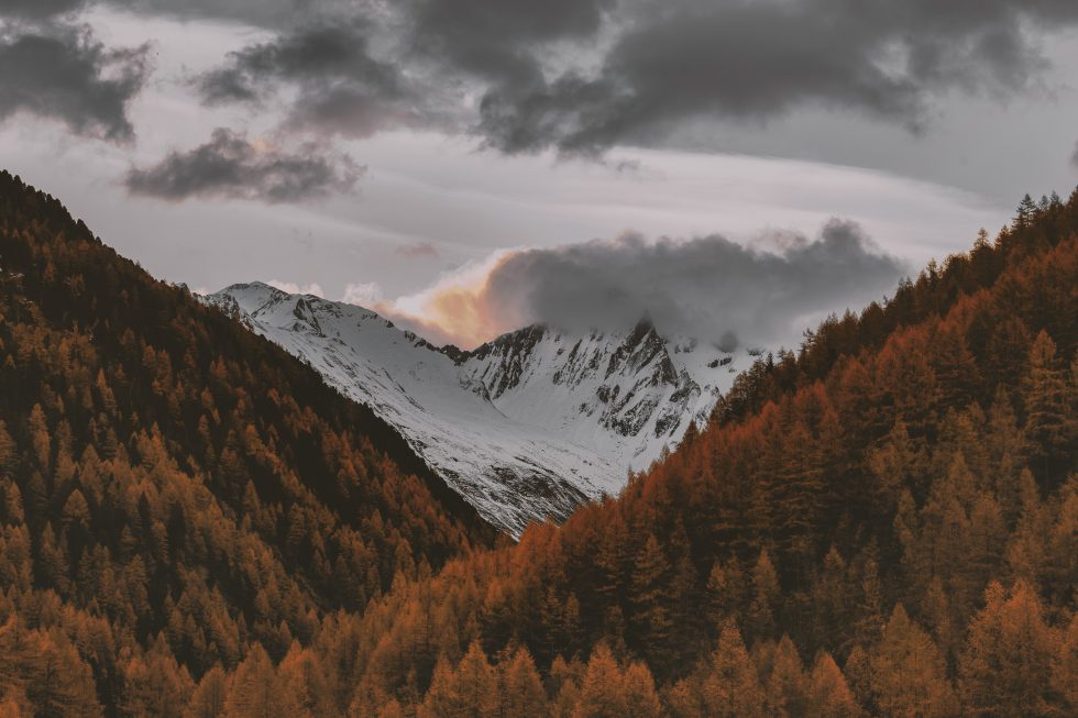 Photography of a snowy mountain during sunset
