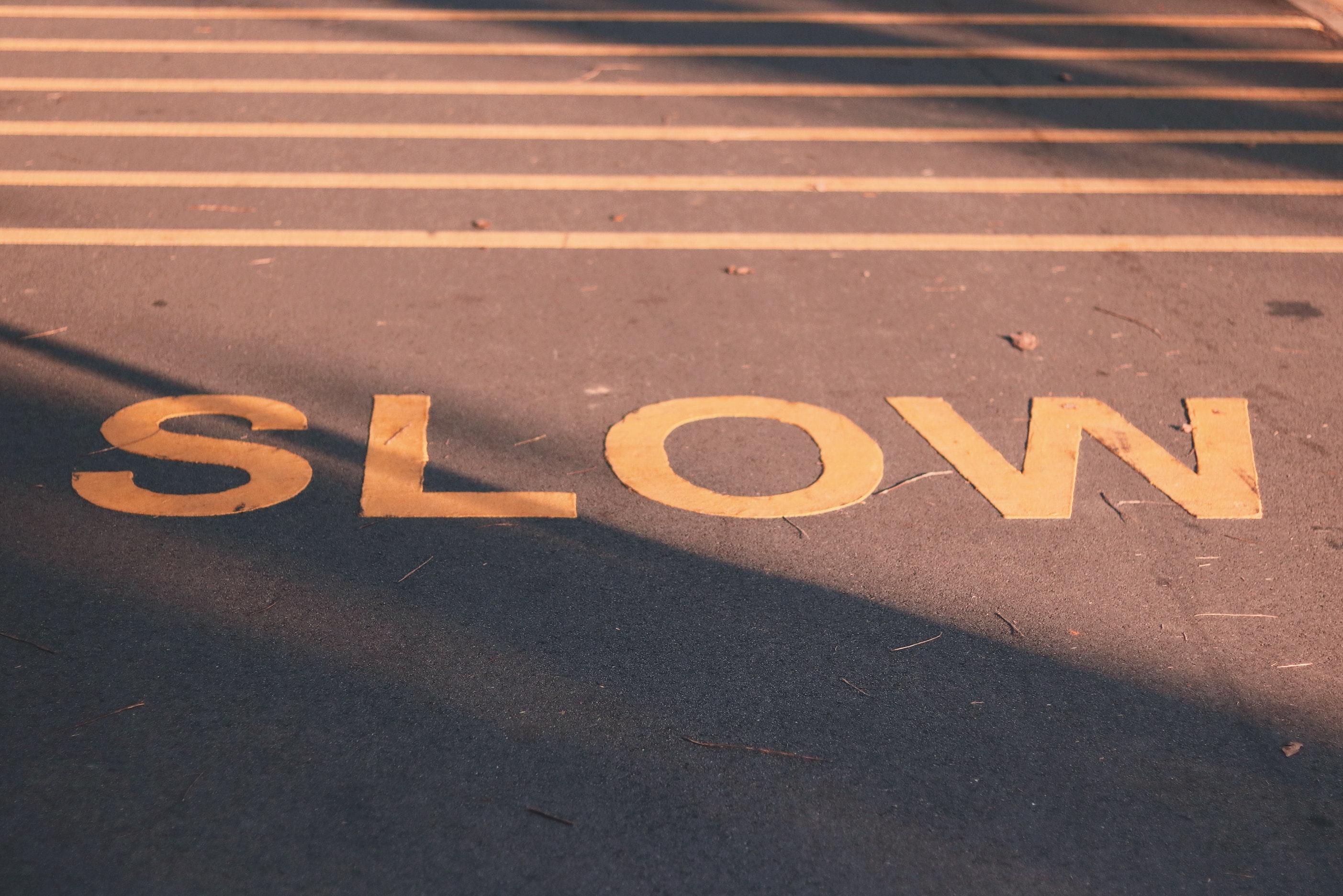 Slow signage on the asphalt road