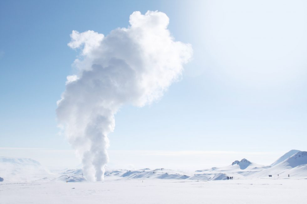 Smoke rising from a snow-covered field