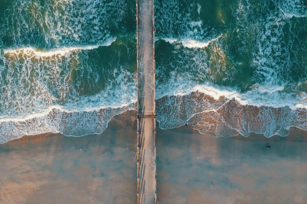 Top view photo of sea waves and a dock