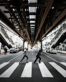 Two boys crossing on a pedestrian lane