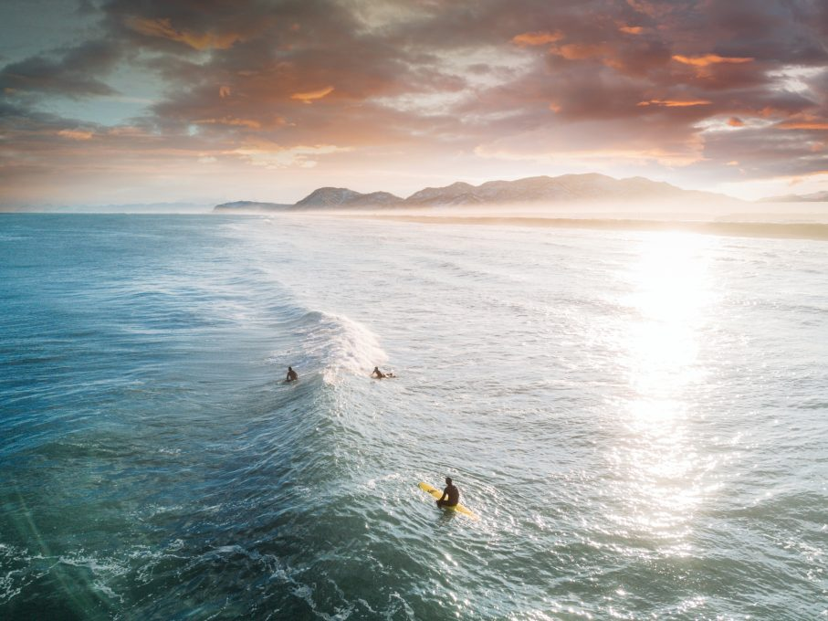 View of three people surfing