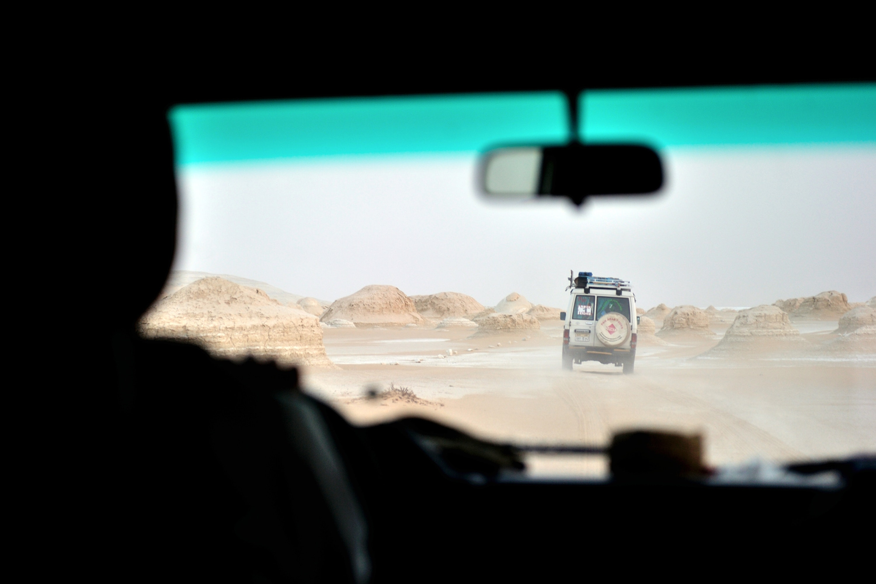 A white vehicle in the desert