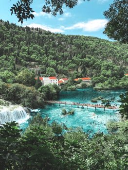 A beautiful landscape with a bridge near the waterfall