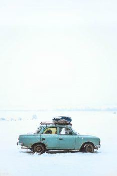 A blue sedan on snow