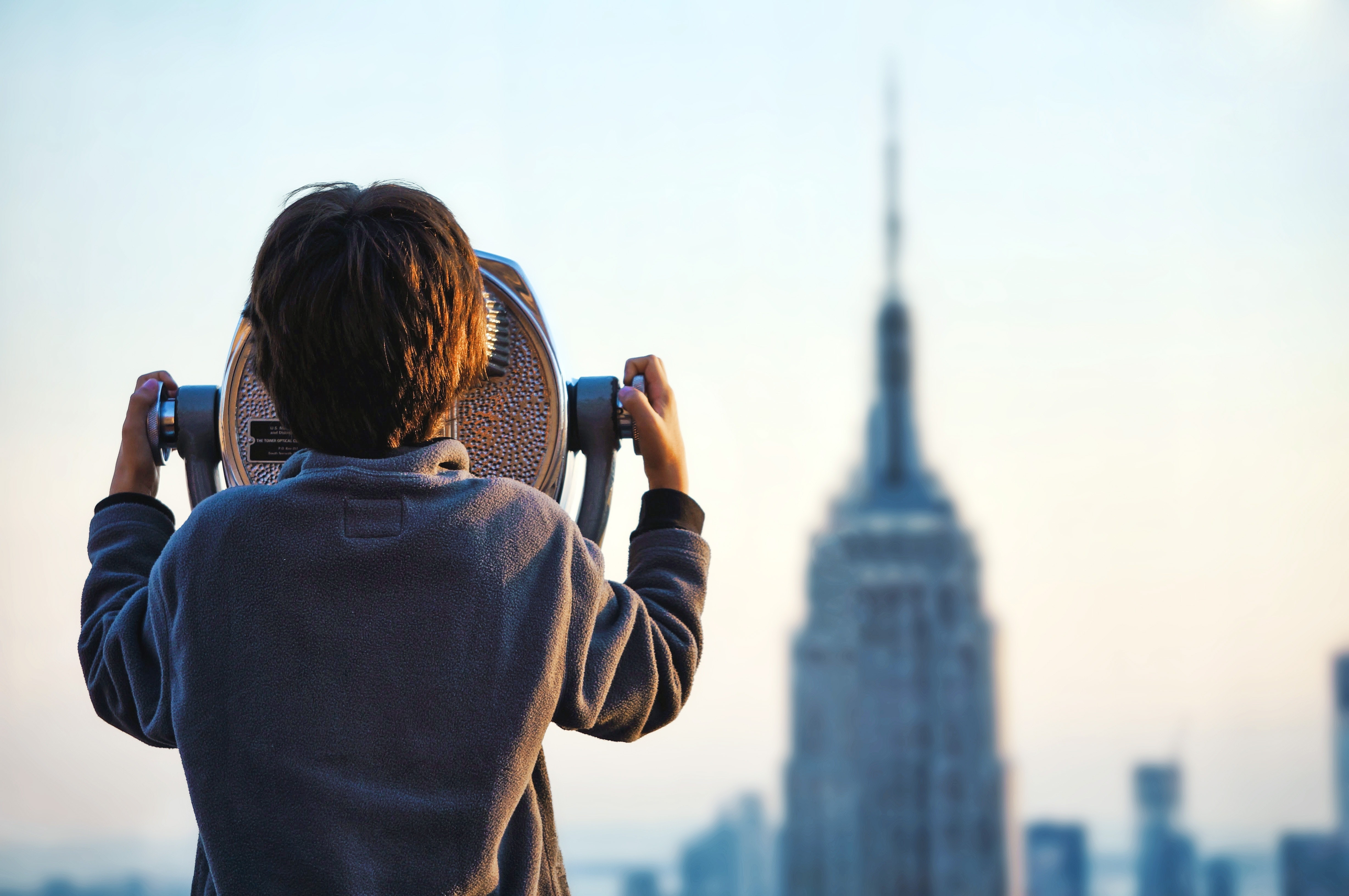 A boy looking at the Empire State Building