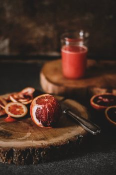 A grapefruit on a chopping board