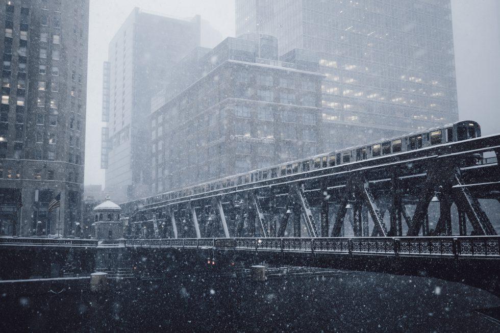 A gray metal bridge during the winter season