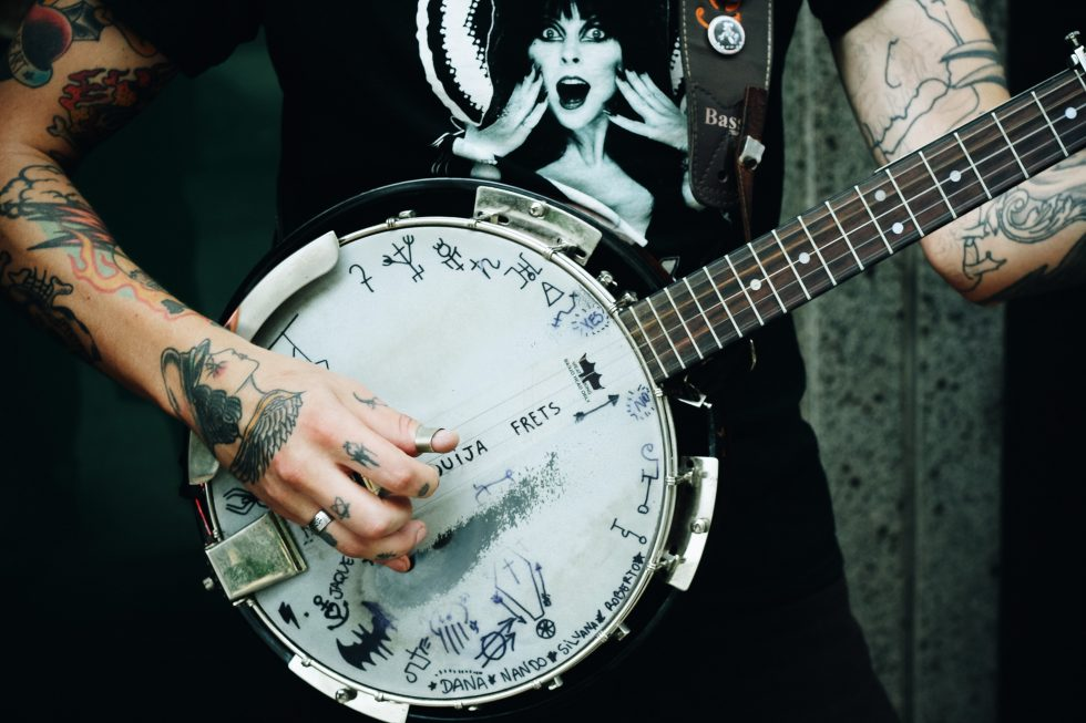 A person holding a banjo