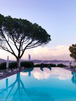 A rectangular swimming pool at sunset