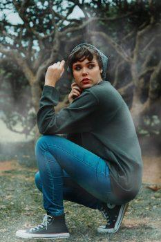 A sitting woman wearing blue denim jeans