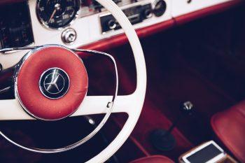 A white Mercedes-Benz steering wheel