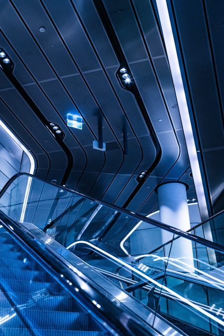 An escalator illuminated with blue light