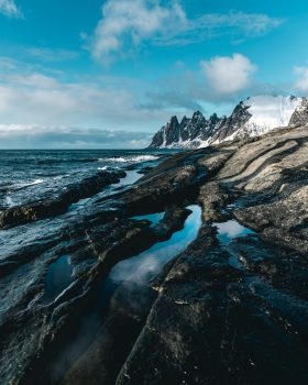 An icy mountain sea waves scenery